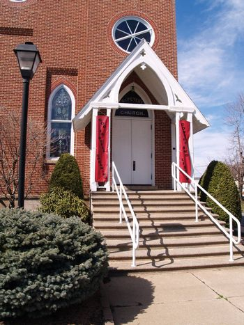 doors and steps for a suburban red brick church
