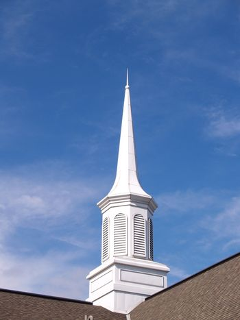 white church steeple with blue sky background