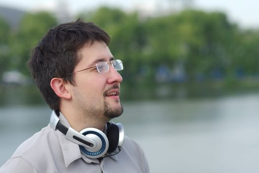 Young smiling man with headphones