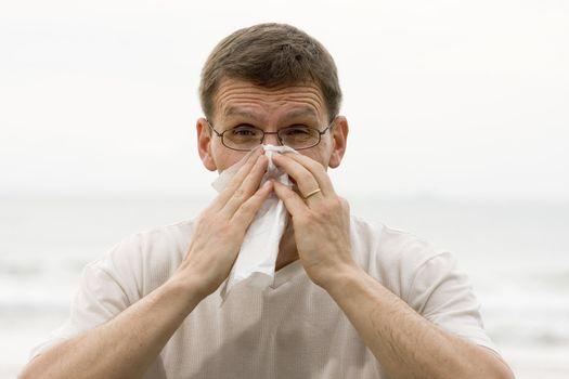 Sneezing man