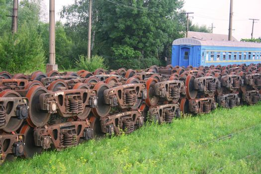 Stacked train wheels at train depot