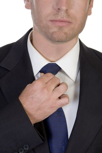 young businessman fastening his tie