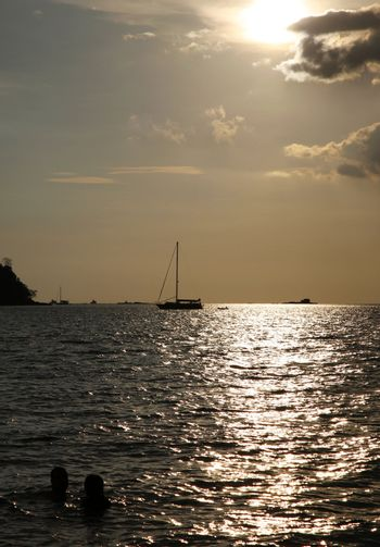 Drifting boat on a sunset