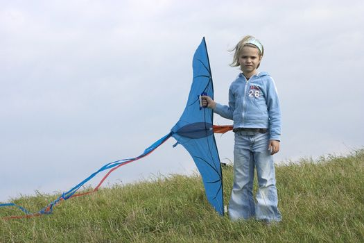 girl with kite in the open air