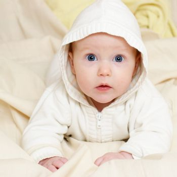 Infant wearing hood