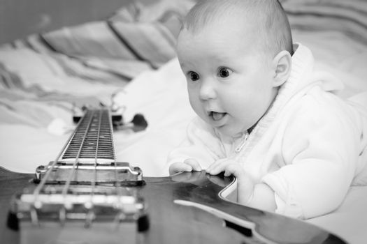 Infant and the bass guitar