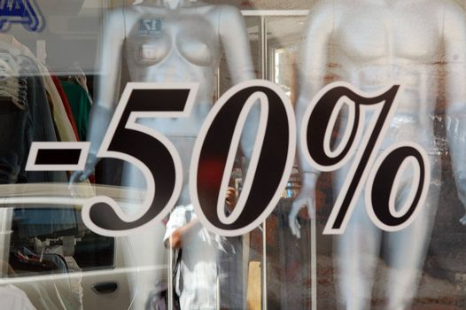 minus fifty percent rebate, advertisment
