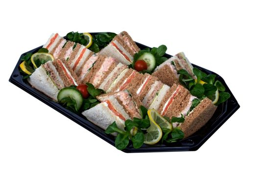 Platter of sandwiches cut into triangles, prepared on a tray for a business lunch