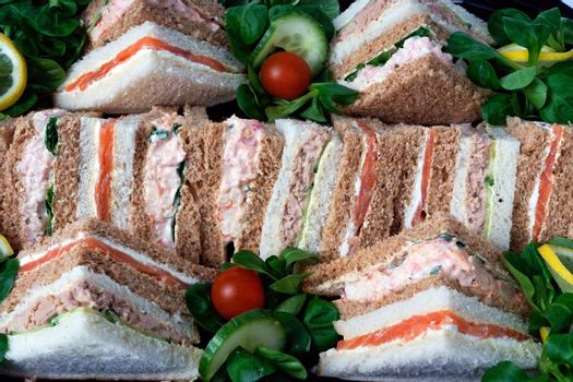 A group of sandwiches cut into triangles for a business lunch