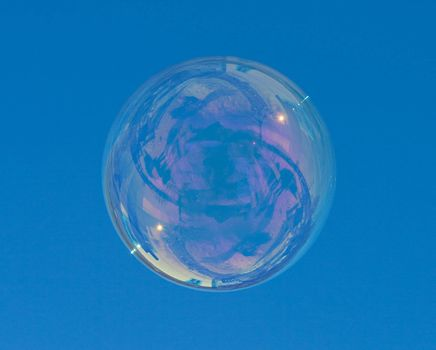 big soap bubble over a blue sky background