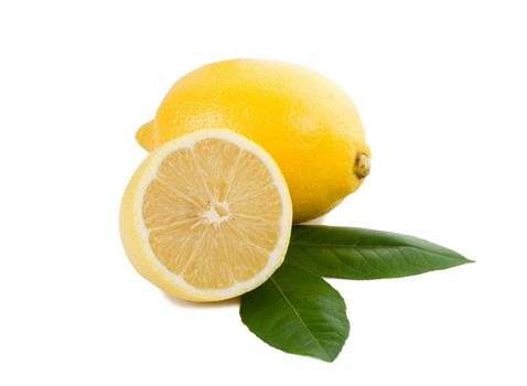 close-up lemon full and half with leaves, isolated on white