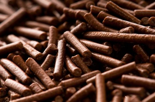 chocolate sprinkles on white background