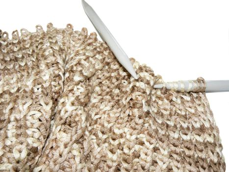 Knitting closeup isolated on white background