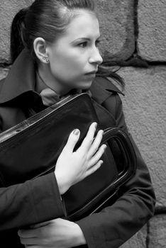 woman in black holding portfolio