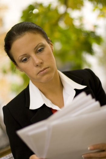 attractive businesswoman with documents