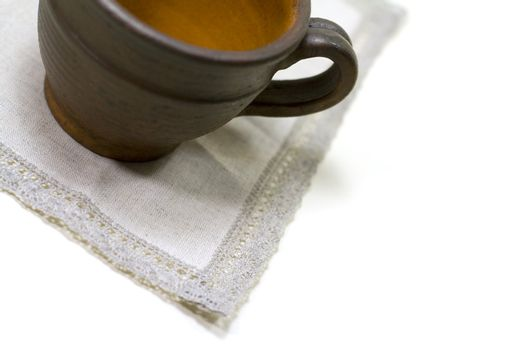 empty coffee cup and linen napkin