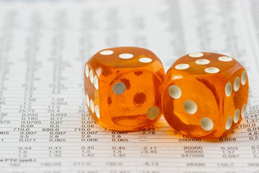 Amber dice on paper