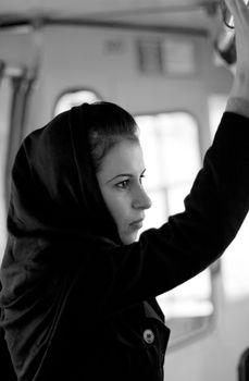 unhappy woman in a bus