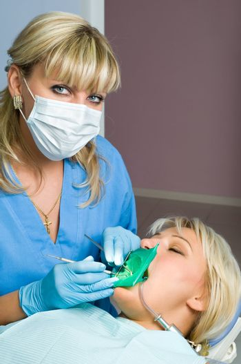 dentistry, doctor and patient, tooth cavity filling