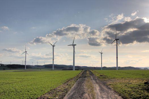 wind turbines near a dirt road