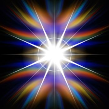 Bright rainbow colored flash of light or lens flare burst over a black background.