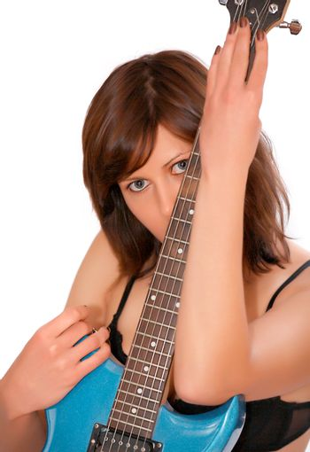 Young beautiful woman with guitar, isolated
