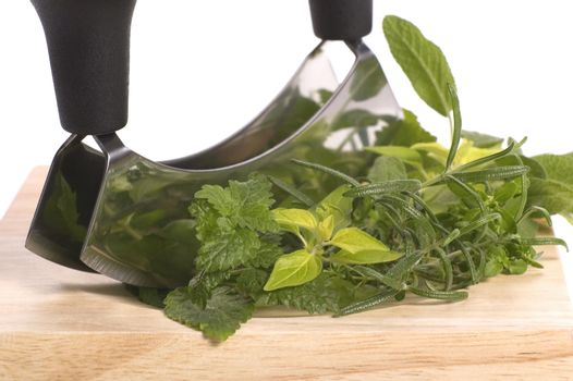 chopping fresh herbs.