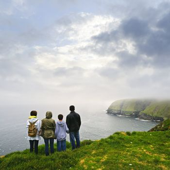 Family looking from cliff at Cape St. Mary's Ecological Bird Sanctuary in Newfoundland, Canada
