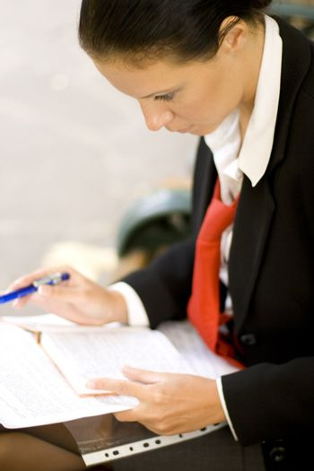 businesswoman is writing note