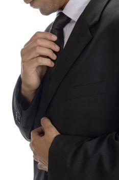 adult man fastening tie