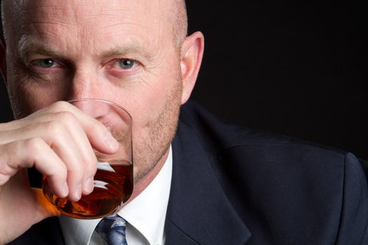 Businessman drinking alcohol