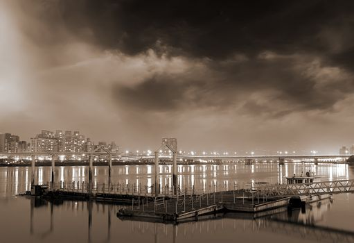 Beautiful city night scenes of dock and apartments