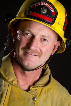 Smiling fireman wearing helmet