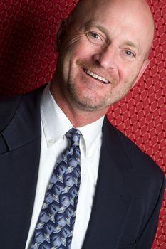 Handsome bald smiling businessman