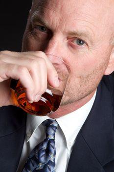 Man drinking whiskey alcohol