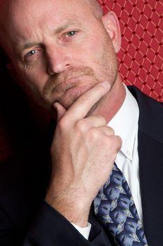 Handsome thinking businessman