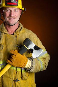 Smiling firefighter holding axe