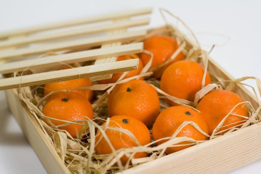 tangerines with straw