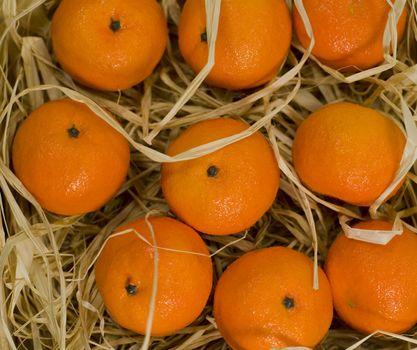 tangerines in straw