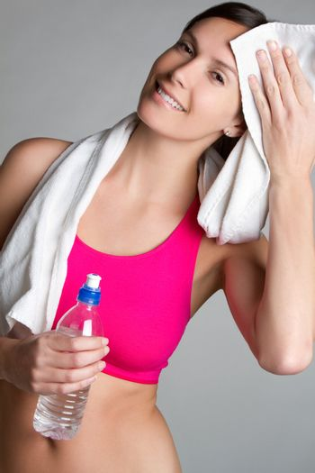 Fitness woman holding water bottle