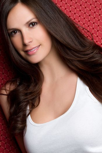 Smiling pretty young brunette woman