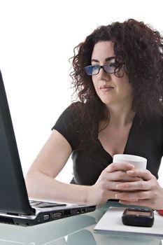 Beautiful brunette, using her laptop. Studio shot, isolated on white background.