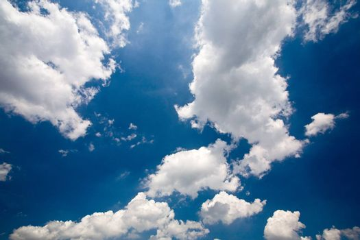 Sunny blue sky with big clouds.