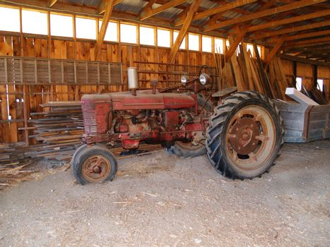 an old tractor inside a barn