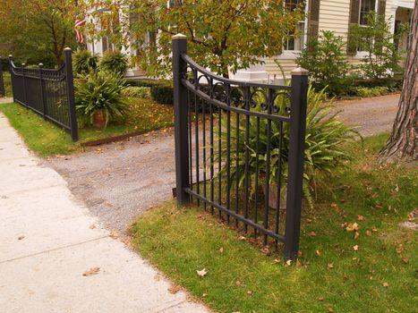 black iron gate by a driveway