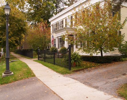 black gate by a colonial style home in Cooperstown, New York