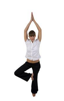 woman doing yoga on one leg in studio
