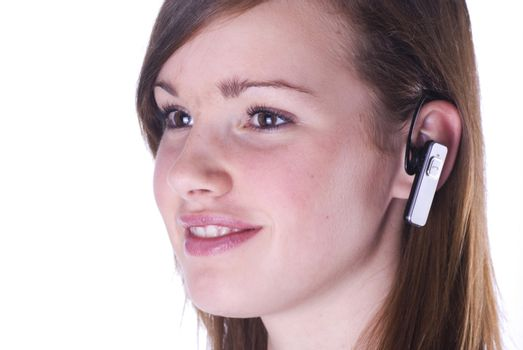 Teenage girl with headset isolated on a white background.