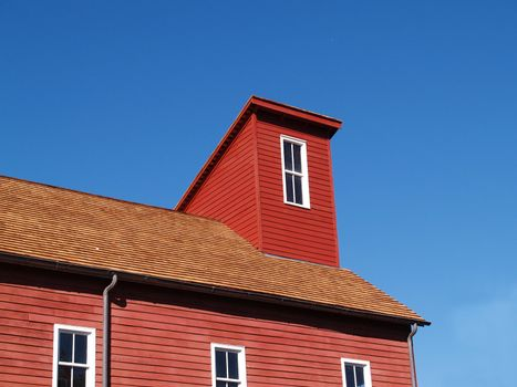 roof and windows for an old red mill in Clinton, New Jersey