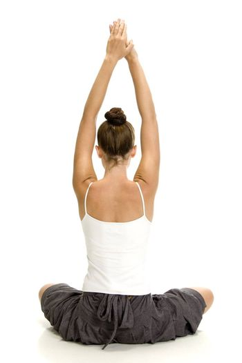 young woman doing yoga on an isolated background